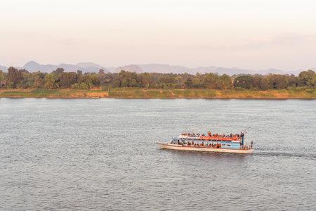 NAKHON PHANOM, THAILAND - NOV 27, 2020 : Tourist boat in Mekong river Nakhon phanom Thailand to Lao Editorial