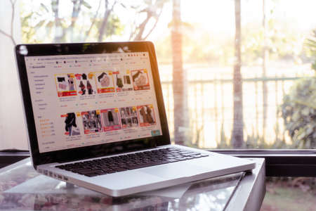 Online shopping website on laptop. Home shopping