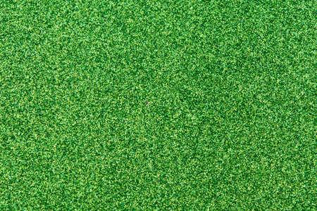 Green glitter texture background Фото со стока