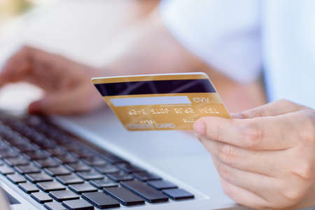 Online Payment . Woman hands holding credit card and using laptop. Online shopping