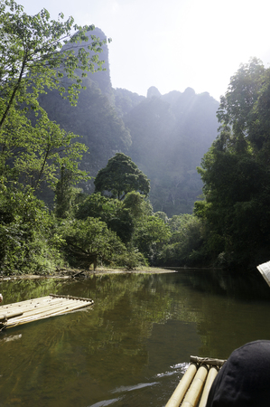 a raft on the river in the jungle in thailand