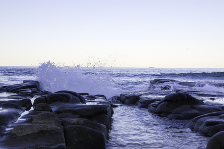 watersplash on the rock at the beach