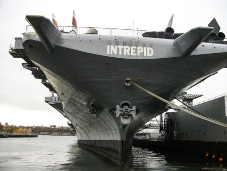 an aircraftcarrier on the dock at the museum