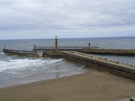 a pier in England by stormy weather during the summer