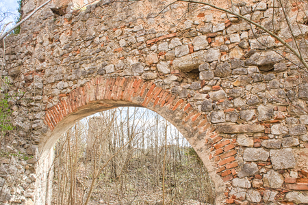 an old door from a ruin in the woods