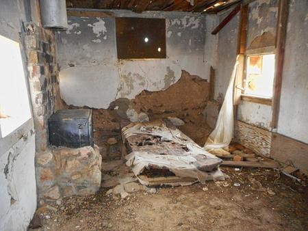 an old house ruin on a farm