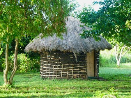 a small hut in the grassland