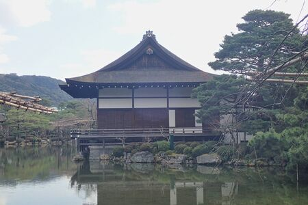 a house in a pond with reflection on the surface