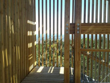 wooden stairways to a tower with sunflares