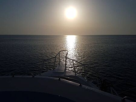 view from the boat to the sea at sunset
