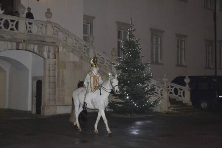 a nicholas is riding on a horse at christmas