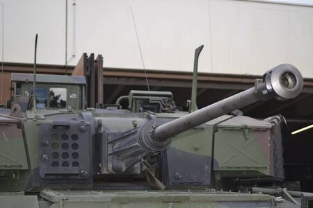a tank is picking up by a truck to move