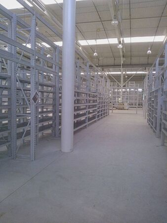 an empty storage hall with shelves in