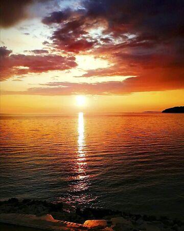 sunset over the ocean in summertime