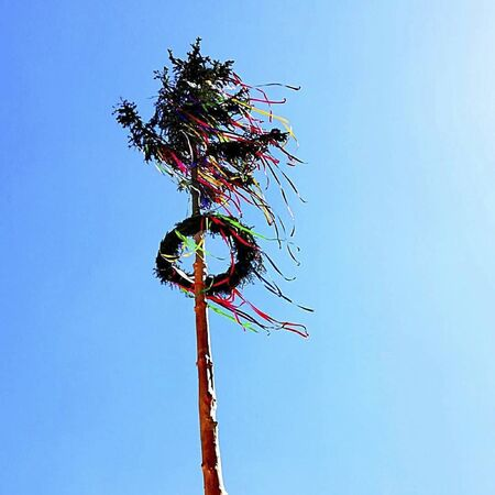a maypole in the wind at summer