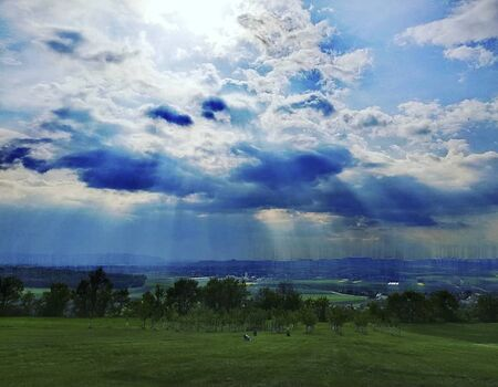 sunflares behind the clouds after the rain Reklamní fotografie