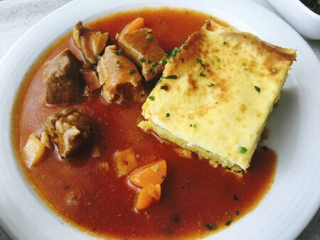 red soup with meat and cheese for meal