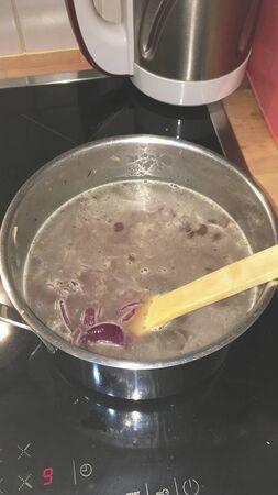 onions in a pot for dinner Reklamní fotografie