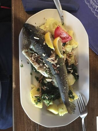 a fish with potatoes and lemon