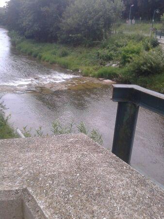 a river dam in the summer time low Foto de archivo