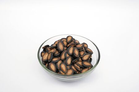 Watermelon seeds are in the glass bowl.isolated on white background.