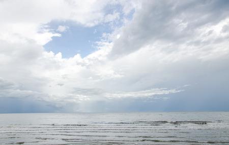 slight: Blue sky and sea with slight cloud. Stock Photo