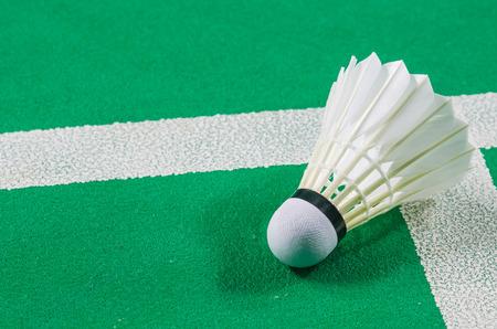 shuttlecock on badminton racket. Imagens