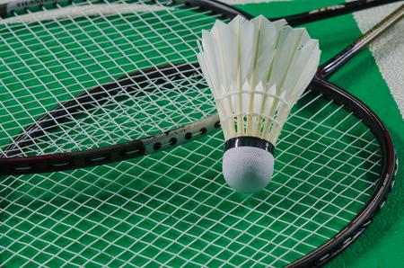 shuttlecock: shuttlecock on badminton racket. Stock Photo