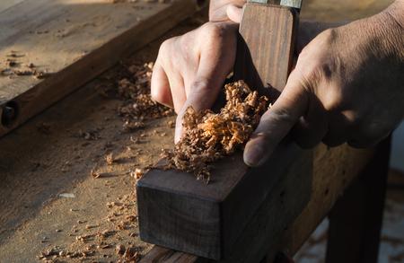 The carpenter was working furniture wood in workshop Stock fotó