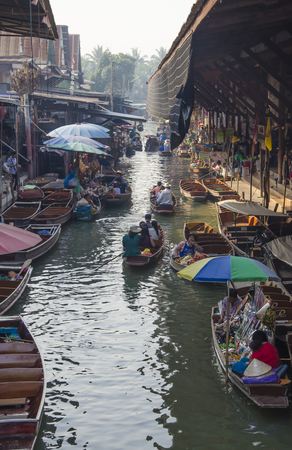 saduak: THAILAND DAMNOEN SADUAK - march 03,2016 : Damnoen Saduak Floating Market Featuring many small boats laden with colourful fruits, vegetables and Thai cuisine Editorial