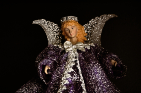 Ceramic angel doll with silver wings and purple gown dress