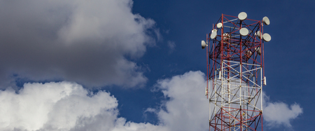 Tower of wireless Internet. Blue sky with clouds in the background