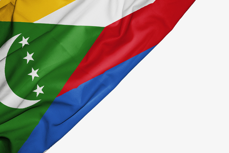 Comoros flag of fabric with copyspace for your text on white background