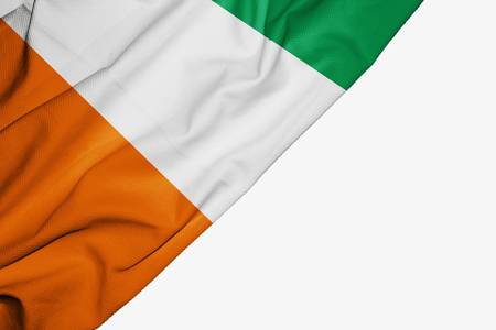 Ivory Coast flag of fabric with copyspace for your text on white background