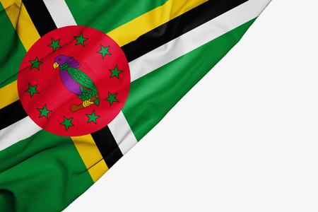 Dominica flag of fabric with copyspace for your text on white background