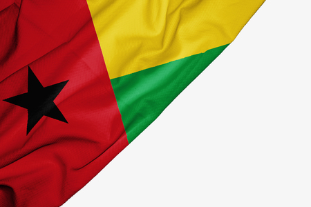 Guinea Bissau flag of fabric with copyspace for your text on white background Stock Photo