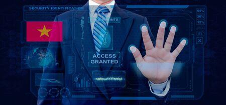 Finger Print Biometric Scanning Identification System. Businessman scan fingerprint biometric identity and approval. Vietnam Nationality Stock Photo
