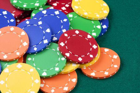 Casino chips, red, yellow, green, orange photo