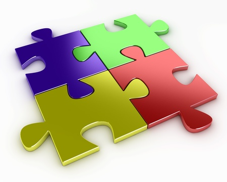 Four puzzle pieces of various colors, red, blue, yellow and green photo