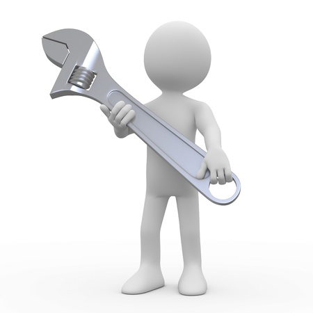 Man with a huge adjustable spanner Stock Photo - 8921173