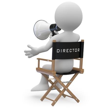 filmregisseur: Filmregisseur zittend in een stoel met een megafoon achteraanzicht Stockfoto
