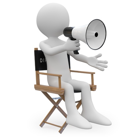 movie director: Film director sitting in a chair with a megaphone Stock Photo