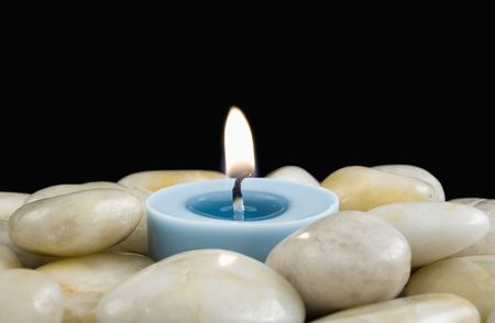 votive candle: Votive Candle Surrounded by White Pebbles