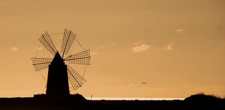 The silhouette of the mill. Stock Photo