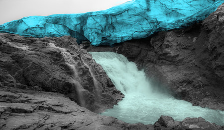 icefall: Waterfall on the glacier in the mountains.