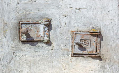 Metal flaps of the old furnace in the village.