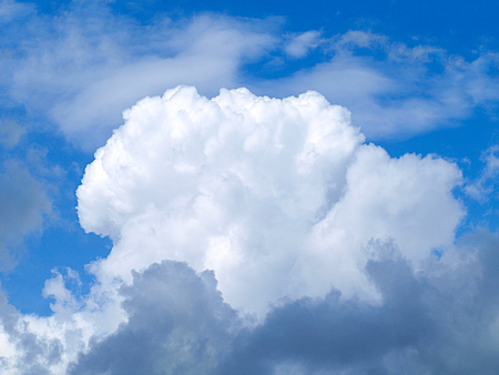 White rain clouds in the blue summer sky. Stock Photo
