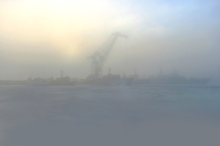 Frozen Baltic sea in the morning in the fog.