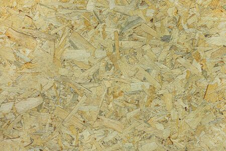 Chipboard sheet closeup, background blank. Texture of pressed wood shavings.