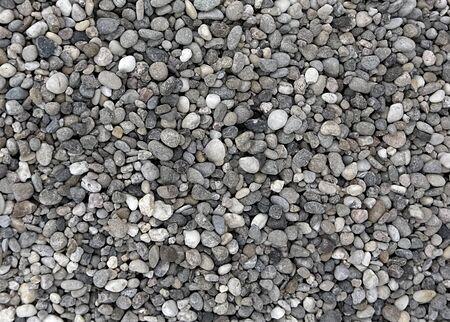 Industrial mining of gravel stones. The texture of fine gravel.